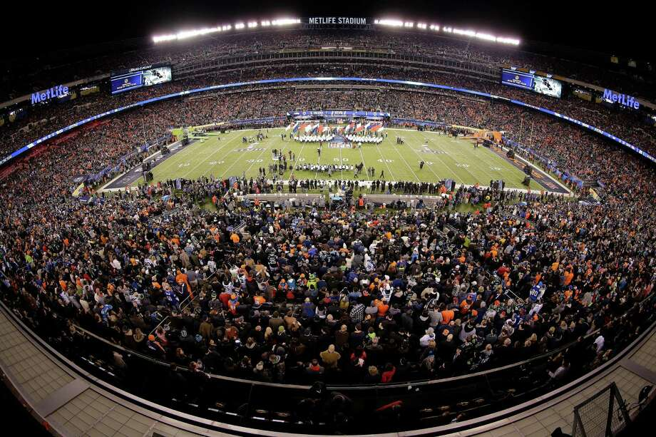 This image made with a fisheye lens shows pre-game activity before the NFL Super Bowl XLVIII football game between the Seattle Seahawks and the Denver Broncos Sunday, Feb. 2, 2014, in East Rutherford, N.J. Photo: Charlie Riedel, AP / AP2014