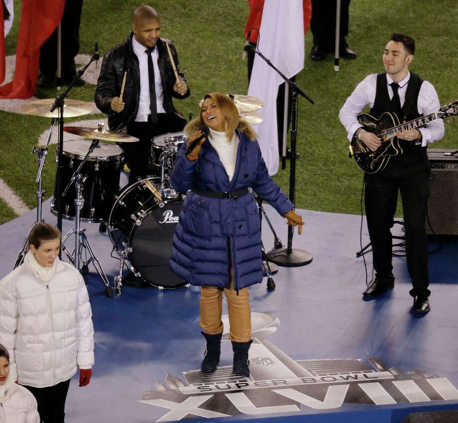 "Queen Latifah sings ""America the Beautiful"" before the NFL Super Bowl XLVIII football game between the Seattle Seahawks and the Denver Broncos Sunday, Feb. 2, 2014, in East Rutherford, N.J. Photo: Mel Evans, AP / AP"