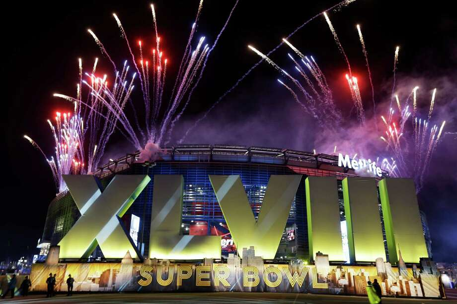 Fireworks burst over MetLife Stadium before the NFL Super Bowl XLVIII football game between the Seattle Seahawks and the Denver Broncos, Sunday, Feb. 2, 2014, in East Rutherford, N.J. Photo: Seth Wenig, AP / AP2014