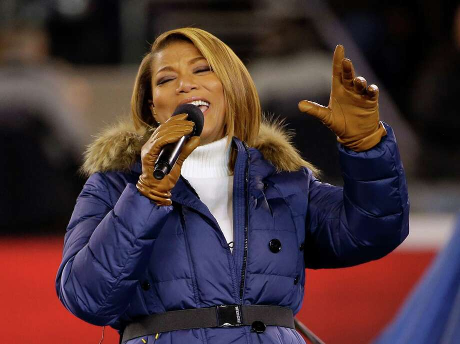 "Queen Latifah sings ""America the Beautiful"" before the NFL Super Bowl XLVIII football game between the Seattle Seahawks and the Denver Broncos Sunday, Feb. 2, 2014, in East Rutherford, N.J. Photo: Matt Slocum, AP / AP"