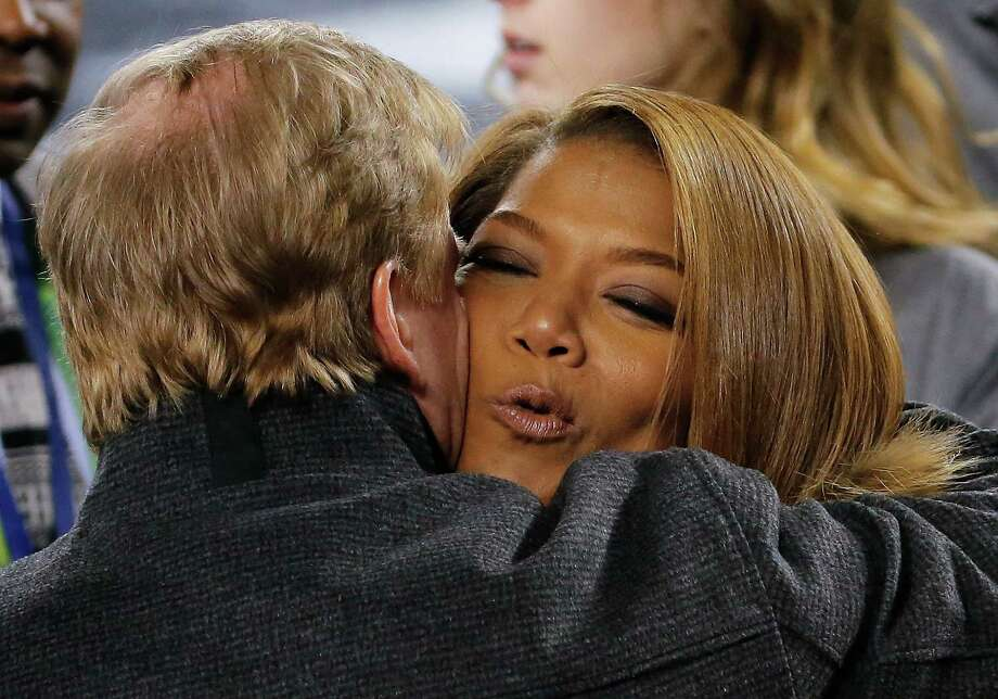 Queen Latifah, right, hugs NFL commissioner Roger Goodell before the NFL Super Bowl XLVIII football game between the Seattle Seahawks and the Denver Broncos Sunday, Feb. 2, 2014, in East Rutherford, N.J. Photo: Matt York, AP / AP