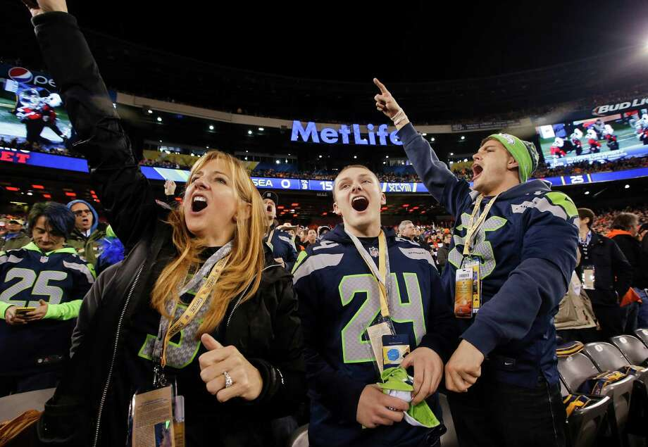 Seattle Seahawks fans cheer before the NFL Super Bowl XLVIII football game between the Seattle Seahawks and the Denver Broncos Sunday, Feb. 2, 2014, in East Rutherford, N.J. Photo: Kathy Willens, AP / AP2014