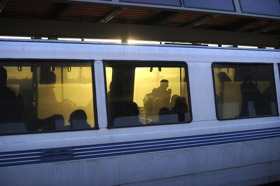 Passengers are seen aboard a train as it prepares to leave the Fruitvale BART station in Oakland, CA, Friday, January 31, 2014. Photo: Michael Short, Special To The Chronicle