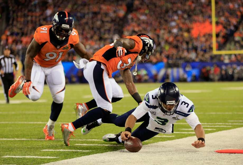 Quarterback Russell Wilson #3 of the Seattle Seahawks runs with ball during the first quarter of Super Bowl XLVIII against Denver Broncos at MetLife Stadium on February 2, 2014 in East Rutherford, New Jersey.  (Photo by Jamie Squire/Getty Images) Photo: Jamie Squire, Getty Images