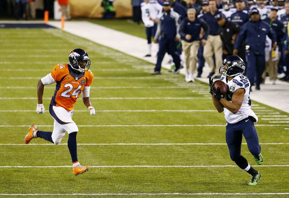 Wide receiver Doug Baldwin #89 of the Seattle Seahawks  runs with ball for a 37 yard pass completion during the first quarter of Super Bowl XLVIII against the Denver Broncos at MetLife Stadium on February 2, 2014 in East Rutherford, New Jersey. Photo: Tom Pennington, Getty Images