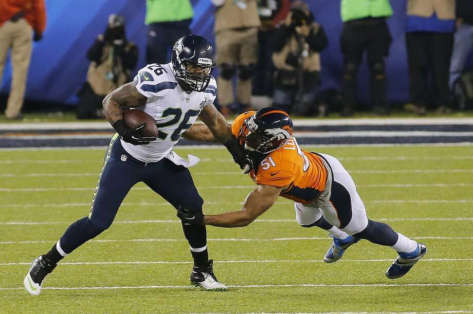 Seattle Seahawks' Michael Robinson (26) runs against Denver Broncos' Paris Lenon during the first half of the NFL Super Bowl XLVIII football game Sunday, Feb. 2, 2014, in East Rutherford, N.J. (AP Photo/Matt York) Photo: Matt York, Associated Press
