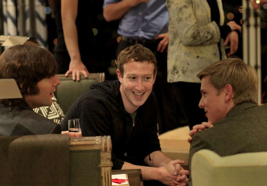 Facebook's Mark Zuckerberg, who recently bought a Dolores Heights home.  Pictured: Zuckerberg (center) visits with friends at the Information event Tuesday December 10, 2013 in San Francisco's Pacific Heights neighborhood. Photo: Brant Ward, The Chronicle