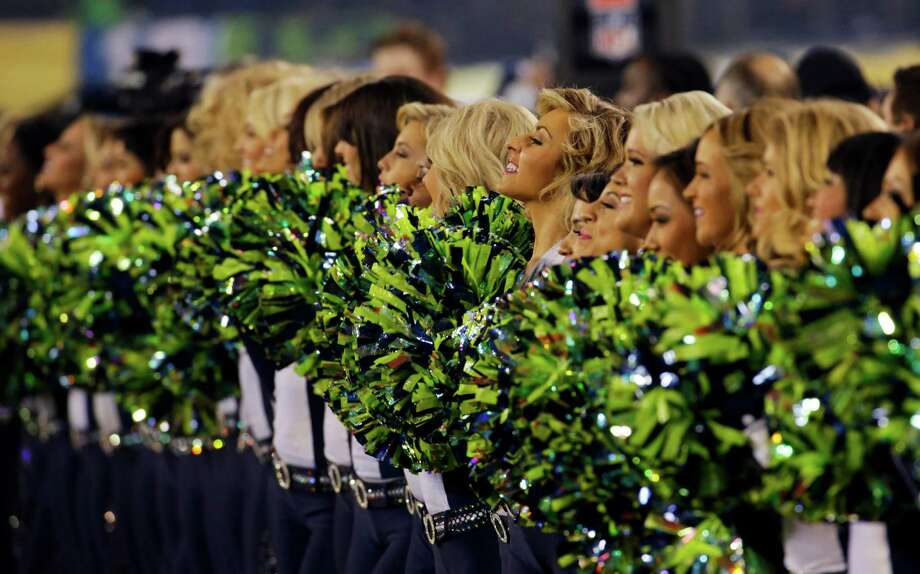 Cheerleaders stand together before the NFL Super Bowl XLVIII football game between the Seattle Seahawks and the Denver Broncos, Sunday, Feb. 2, 2014, in East Rutherford, N.J. Photo: Ted S. Warren, AP / AP