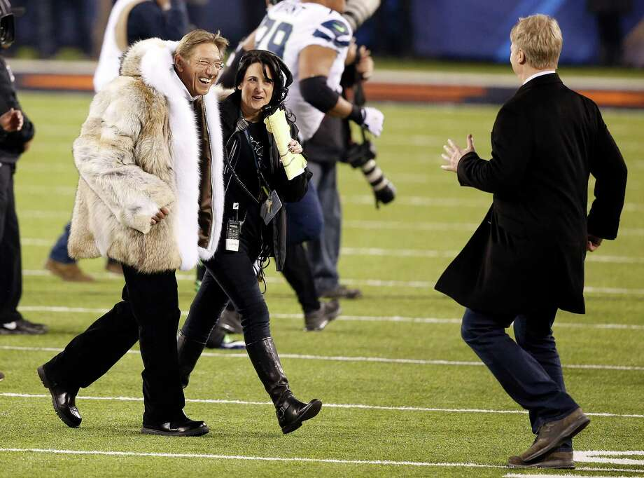 Former NFL quarterbacks Joe Namath, left, and Phil Simms, right, walk off the field after the coin toss before the NFL Super Bowl XLVIII football game between the Seattle Seahawks and the Denver Broncos Sunday, Feb. 2, 2014, in East Rutherford, N.J. Photo: Kathy Willens, AP / AP