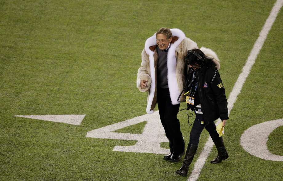 Former NFL player Joe Namath walks to mid-field for the coin toss before the NFL Super Bowl XLVIII football game between the Seattle Seahawks and the Denver Broncos Sunday, Feb. 2, 2014, in East Rutherford, N.J. Photo: Charlie Riedel, AP / AP