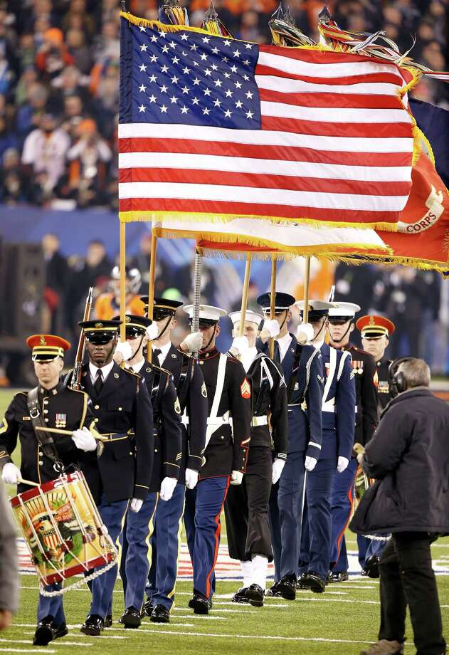 The flag is presented for the national anthem before the NFL Super Bowl XLVIII football game between the Seattle Seahawks and the Denver Broncos Sunday, Feb. 2, 2014, in East Rutherford, N.J. Photo: Kathy Willens, AP / AP