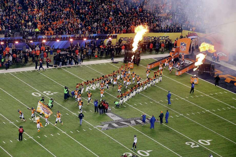 The Denver Broncos run onto the field before the NFL Super Bowl XLVIII football game against the Seattle Seahawks Sunday, Feb. 2, 2014, in East Rutherford, N.J. Photo: Mel Evans, AP / AP