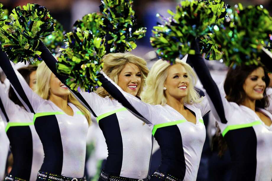 Seattle Seahawks cheerleaders perform before the NFL Super Bowl XLVIII football game against the Denver Broncos Sunday, Feb. 2, 2014, in East Rutherford, N.J. Photo: Ben Margot, AP / AP