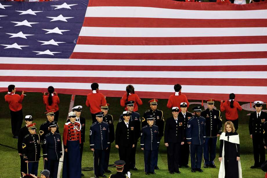 Opera singer Renee Fleming, right,  sings the national anthem before the NFL Super Bowl XLVIII football game between the Seattle Seahawks and the Denver Broncos Sunday, Feb. 2, 2014, in East Rutherford, N.J. Photo: Charlie Riedel, AP / AP