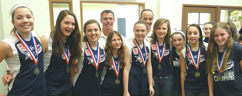 Westport Wreckers Little League softball state champions Natalie Schenck, Maddie McGarry, Erin McWhirter, Coach Mark McWhirter, Ellie Klein, Coach Lou Alfero, Madeline Howard, Hannah Fischer, Tilly Yacenda, Sophia Alfero and Kate Feinberg at the Westport Center for Senior Activities' Super Bowl tailgate party Sunday. Photo: Mike Lauterborn / Westport News