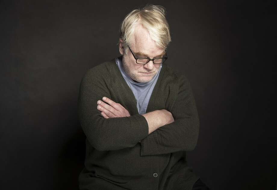 This photo taken Jan. 19, 2014, shows Phillip Seymour Hoffman posing for a portrait at The Collective and Gibson Lounge Powered by CEG, during the Sundance Film Festival, in Park City, Utah.  Hoffman, who won the Oscar for his portrayal of writer Truman Capote and created a gallery of slackers, charlatans and other characters so vivid that he was regarded as one of the world's finest actors, was found dead in his New York apartment Sunday with what officials said was a needle in his arm. He was 46. (Photo by Victoria Will/Invision/AP) Photo: Victoria Will, Associated Press