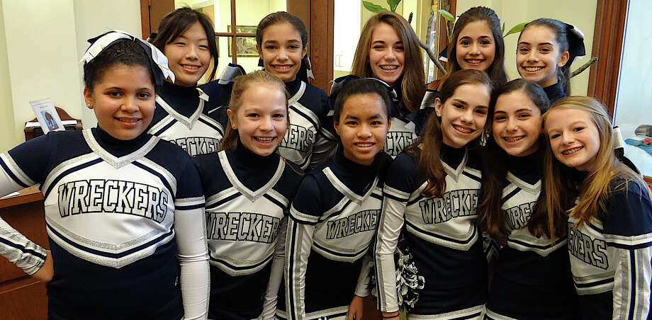 Westport P.A.L. Wreckers cheerleading sqaud at the tailgate party Sunday at the Westport Center for Senior Activities. Photo: Mike Lauterborn / Westport News