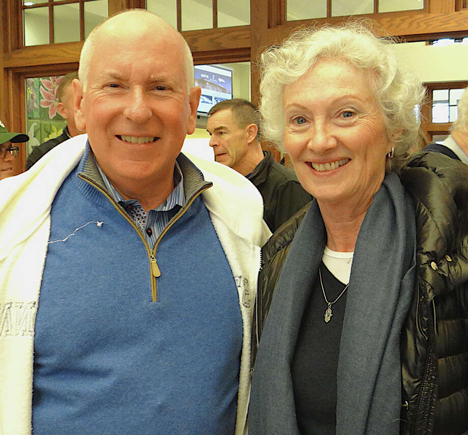 First Selectman Jim Marpe and Human Services Director Barbara Butler at the Westport Center for Senior Activities' Super Bowl tailgate party. Photo: Mike Lauterborn / Westport News
