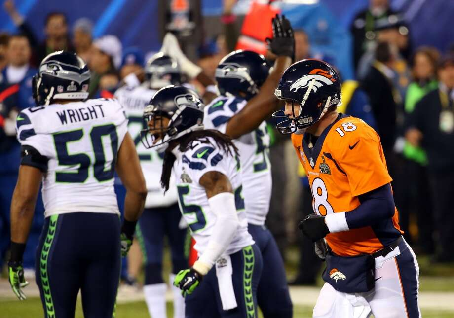 Peyton Manning jogs off the field after the Seahawks forced a safety against the Broncos. Photo: Ronald Martinez, Getty Images