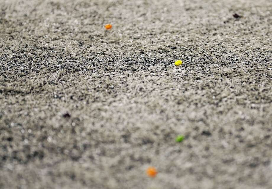 Skittles land on the field after Seattle Seahawks' Marshawn Lynch scored a touchdown during the first half of the NFL Super Bowl XLVIII football game against the Denver Broncos, Sunday, Feb. 2, 2014, in East Rutherford, N.J. (AP Photo/Matt Slocum) Photo: Matt Slocum, Associated Press