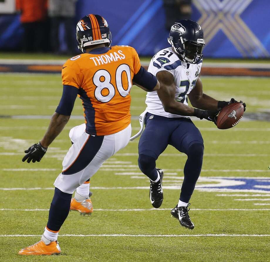 Seattle Seahawks strong safety Kam Chancellor (31) intercepts a pass intended for Denver Broncos tight end Julius Thomas (80) during the first half of the NFL Super Bowl XLVIII football game Sunday, Feb. 2, 2014, in East Rutherford, N.J. (AP Photo/Matt York) Photo: Matt York, Associated Press