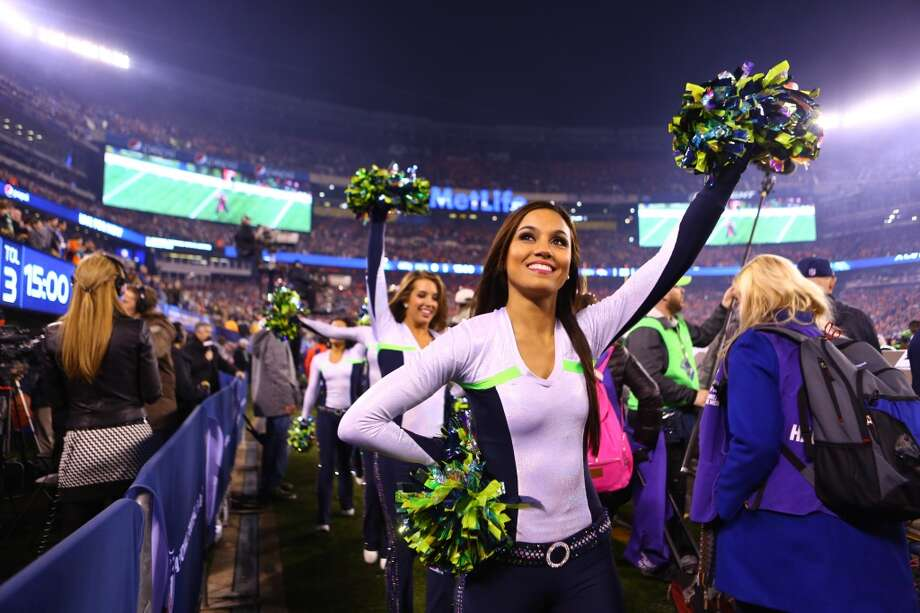 The Seattle Seahawks Sea Gals take the field before the game at MetLife Stadium for at Super Bowl XLVIII Sunday, Feb. 2, 2014, in New Jersey. (Joshua Trujillo, seattlepi.com) Photo: JOSHUA TRUJILLO, SEATTLEPI.COM