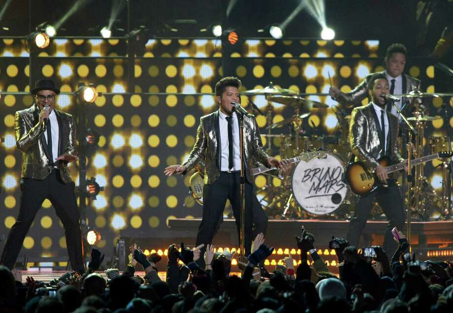 Bruno Mars performs performs during the halftime show of the NFL Super Bowl XLVIII football game between the Seattle Seahawks and the Denver Broncos Sunday, Feb. 2, 2014, in East Rutherford, N.J. Photo: Bill Kostroun, AP / FR51951 AP