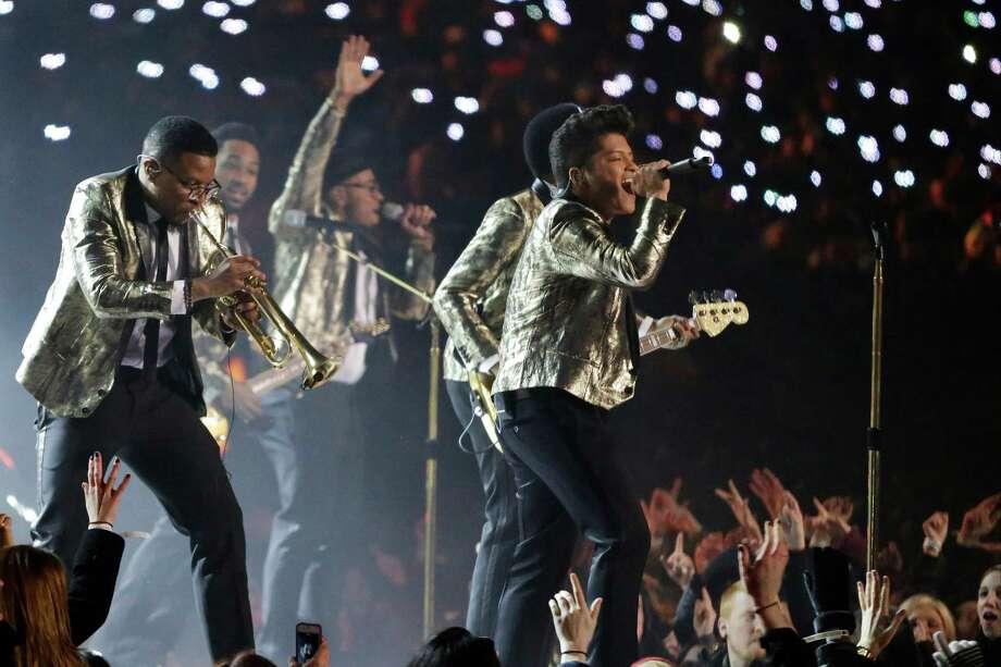 Bruno Mars performs during the halftime show of the NFL Super Bowl XLVIII football game Sunday, Feb. 2, 2014, in East Rutherford, N.J. Photo: Julio Cortez, AP / AP