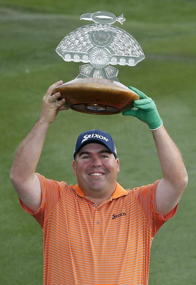 It took 239 starts on the PGA Tour, but Kevin Stadler finally gets to hoist his first title trophy. Photo: Ross D. Franklin, Associated Press