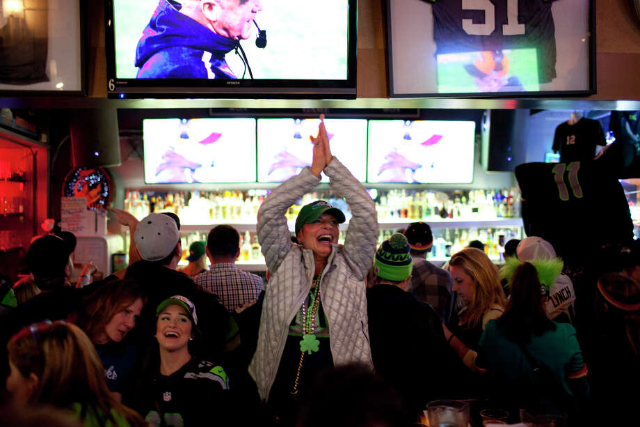 Kitty O'Connor, of Seattle, celebrates at Fuel in Pioneer Square at during the third quarter of Super Bowl XLVIII on Sunday, February 2, 2014 in Seattle. Photo: (Chris Wilson,  Seattlepi.com)