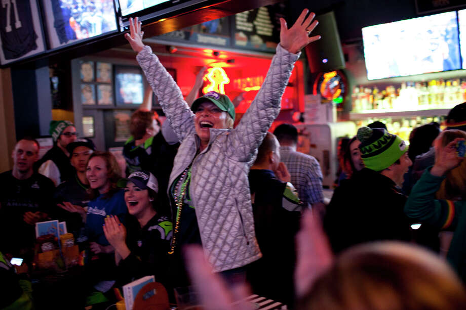 Kitty O'Connor, of Seattle, celebrates at Fuel in Pioneer Square at during the third quarter of Super Bowl XLVIII on Sunday, February 2, 2014 in Seattle. Photo: CHRIS WILSON, (Chris Wilson, Seattlepi.com)