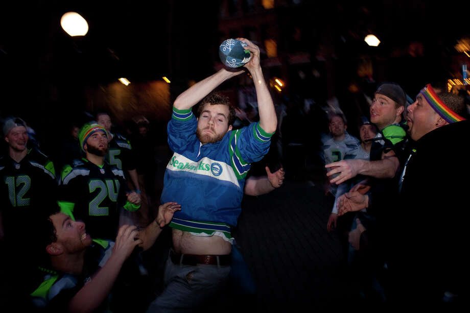 Fans play catch at Occidental Park in Pioneer Square at half time of Super Bowl XLVIII on Sunday, February 2, 2014 in Seattle. Photo: CHRIS WILSON, (Chris Wilson, Seattlepi.com)