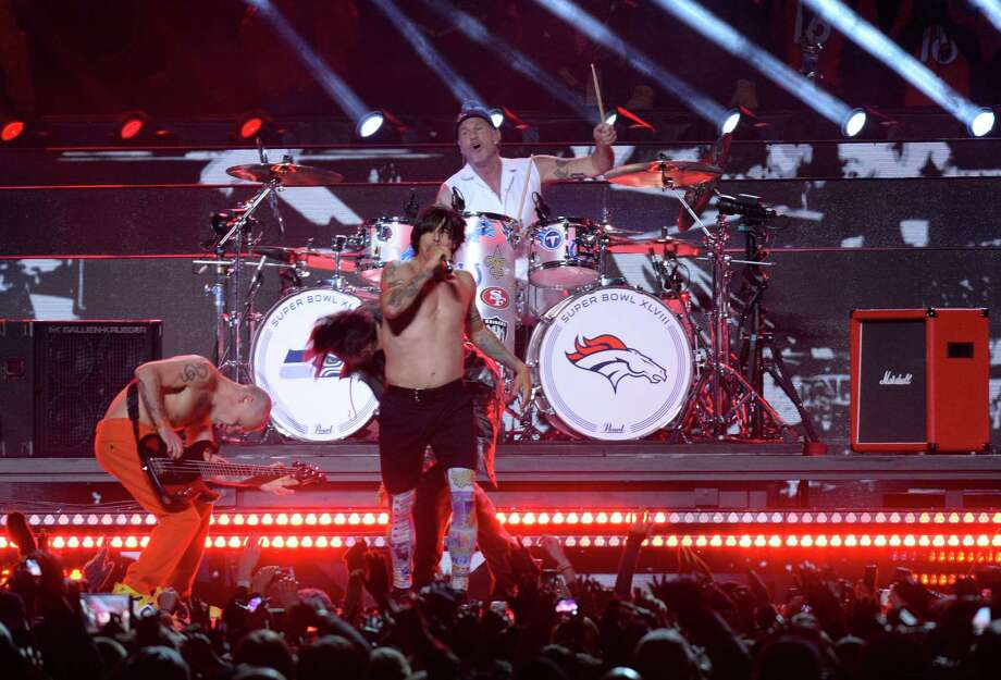 The Red Hot Chili Peppers perform during Super Bowl 48 at MetLife stadium in East Rutherford, New Jersey, on February 2, 2014.    AFP PHOTO /   Timothy  CLARY Photo: TIMOTHY A. CLARY, Getty Images / 2014 AFP