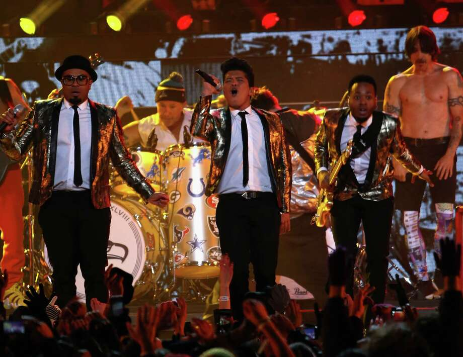 Bruno Mars performs with the Red Hot Chili Peppers during the Pepsi Super Bowl XLVIII Halftime Show at MetLife Stadium on February 2, 2014 in East Rutherford, New Jersey. Photo: Larry Busacca, Getty Images / 2014 Getty Images