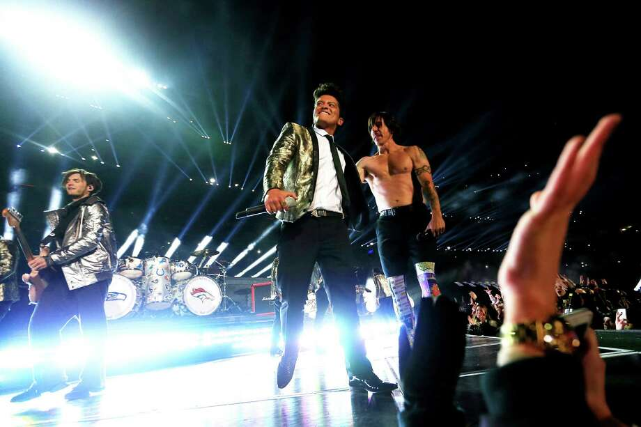 Bruno Mars and Anthony Kiedis of the Red Hot Chili Peppers perform during the Pepsi Super Bowl XLVIII Halftime Show at MetLife Stadium on February 2, 2014 in East Rutherford, New Jersey. Photo: Jamie Squire, Getty Images / 2014 Getty Images