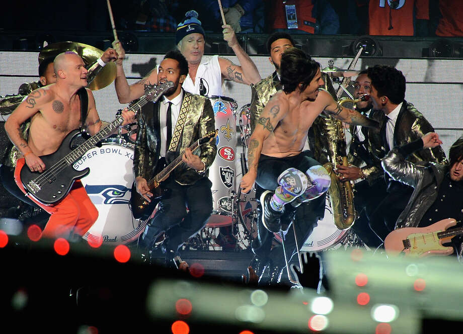 Flea, Chad Smith, Anthony Kiedis, Bruno Mars, and Josh Klinghoffer perform during the Pepsi Super Bowl XLVIII Halftime Show at MetLife Stadium on February 2, 2014 in East Rutherford, New Jersey.  (Photo by Theo Wargo/FilmMagic) Photo: Theo Wargo, Getty Images / 2014 FilmMagic