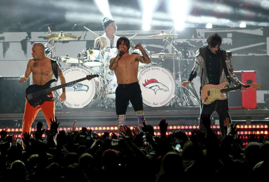 Flea, Chad Smith, Anthony Kiedis and Josh Klinghoffer of the Red Hot Chili Peppers perform during the Pepsi Super Bowl XLVIII Halftime Show at MetLife Stadium on February 2, 2014 in East Rutherford, New Jersey. Photo: Larry Busacca, Getty Images / 2014 Getty Images