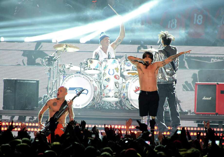 (L-R) Flea,  Chad Smith, Anthony Kiedis, and Josh Klinghoffer of the Red Hot Chili Peppers perform during the Pepsi Super Bowl XLVIII Halftime Show at MetLife Stadium on February 2, 2014 in East Rutherford, New Jersey.  (Photo by Theo Wargo/FilmMagic) Photo: Theo Wargo, Getty Images / 2014 FilmMagic