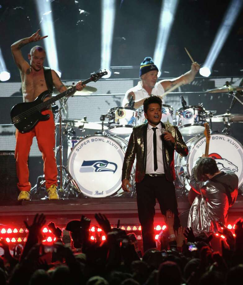 Bruno Mars with Flea and Chad Smith of the Red Hot Chili Peppers perform during the Pepsi Super Bowl XLVIII Halftime Show at MetLife Stadium on February 2, 2014 in East Rutherford, New Jersey. Photo: Larry Busacca, Getty Images / 2014 Getty Images