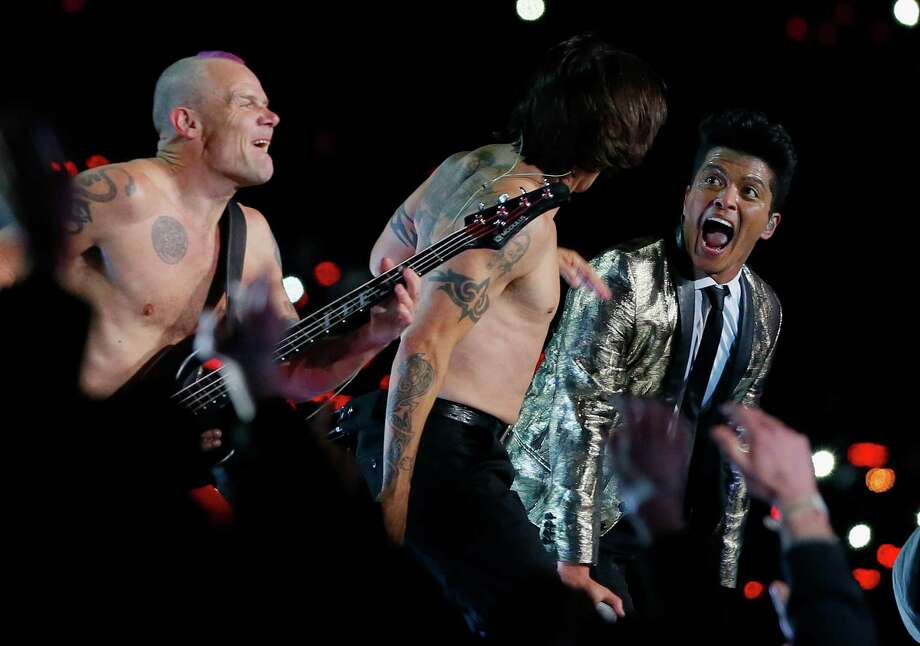 Bruno Mars performs with Anthony Kiedis and Flea of the Red Hot Chili Peppers during the Pepsi Super Bowl XLVIII Halftime Show at MetLife Stadium on February 2, 2014 in East Rutherford, New Jersey. Photo: Kevin C. Cox, Getty Images / 2014 Getty Images