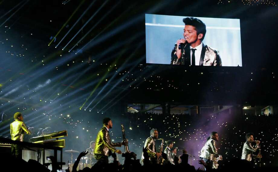 Bruno Mars performs during the Pepsi Super Bowl XLVIII Halftime Show at MetLife Stadium on February 2, 2014 in East Rutherford, New Jersey. Photo: Kevin C. Cox, Getty Images / 2014 Getty Images
