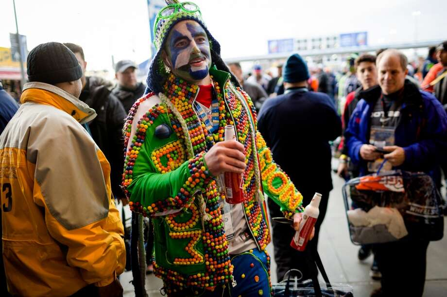 A Skittles-laden man enjoys a beer before Super Bowl XLVIII Sunday, Feb. 2, 2014, at MetLife Stadium in New Jersey. (Jordan Stead, seattlepi.com) Photo: JORDAN STEAD, SEATTLEPI.COM