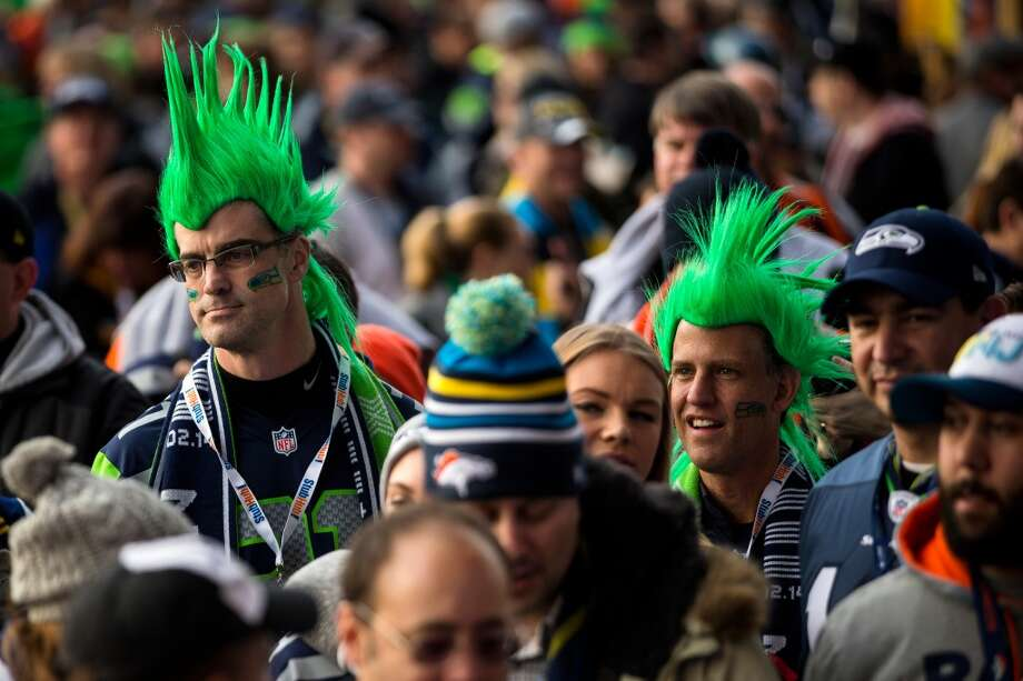 Green-haired Seahawks fans watch pregame activities before Super Bowl XLVIII Sunday, Feb. 2, 2014, at MetLife Stadium in New Jersey. (Jordan Stead, seattlepi.com) Photo: JORDAN STEAD, SEATTLEPI.COM