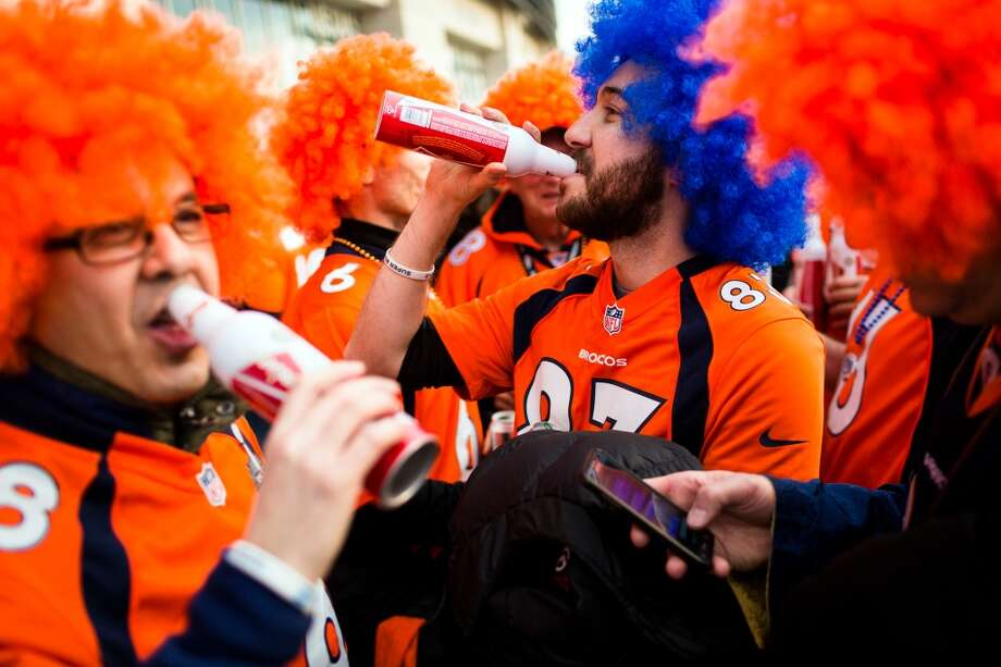 Broncos fans imbibe before Super Bowl XLVIII Sunday, Feb. 2, 2014, at MetLife Stadium in New Jersey. (Jordan Stead, seattlepi.com) Photo: JORDAN STEAD, SEATTLEPI.COM