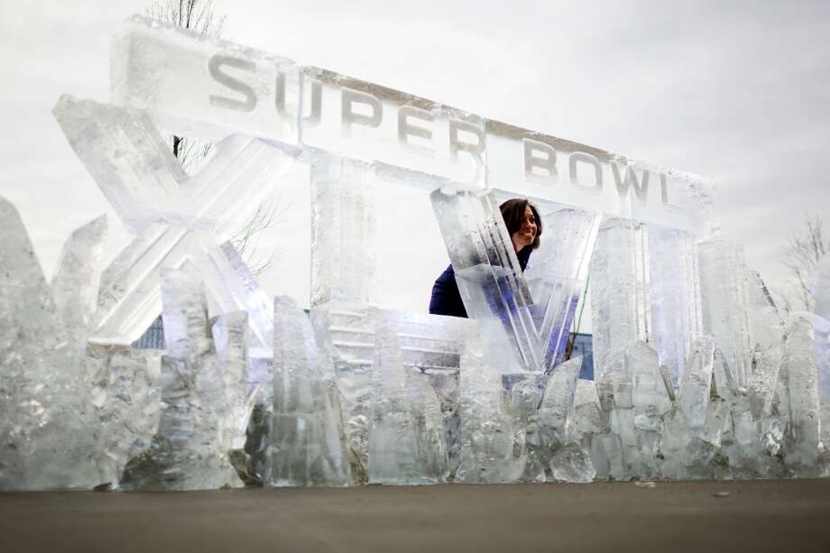 A woman poses for a portrait behind a Super Bowl XLVIII ice carving Sunday, Feb. 2, 2014, at MetLife Stadium in New Jersey. (Jordan Stead, seattlepi.com) Photo: JORDAN STEAD, SEATTLEPI.COM