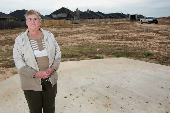 Judy Paskins and her neighbors have been waiting months for the Postal Service to put mailboxes in their Katy community.
