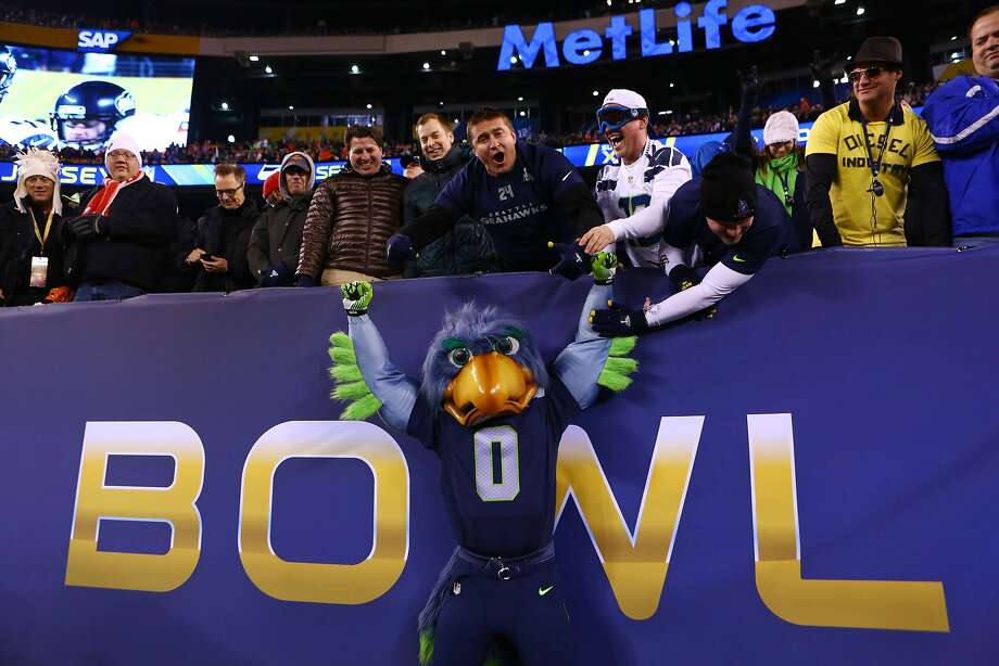 Buzz the Seattle Seahawks mascot celebrates with fans during Super Bowl XLVIII Sunday, Feb. 2, 2014, at MetLife Stadium in New Jersey. (Joshua Trujillo, seattlepi.com) Photo: Joshua Trujillo, SEATTLEPI.COM