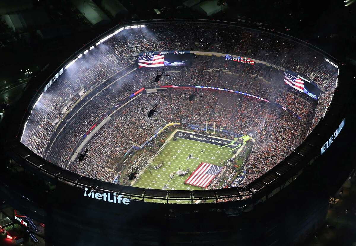 EAST RUTHERFORD, NJ - FEBRUARY 02: U.S. Army helicopters from the 101st Combat Aviation Brigade fly over Metlife Stadium ahead of Super Bowl XLVIII between the Seattle Seahawks and the Denver Broncos on February 2, 2014 in East Rutherford, New Jersey.Metlife Stadium, in East Rutherford, N.J., has not revealed their potential plan of reopening the stadium. The stadium hosts both the New York Giants and New York Jets.