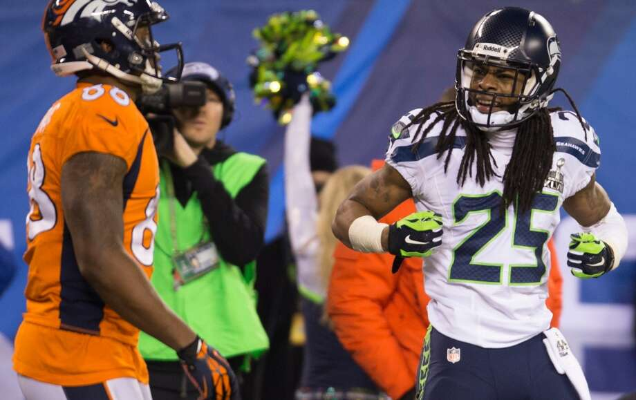 Seattle's Richard Sherman, right, has words for Denver's Demaryius Thomas, left, during the third quarter in Super Bowl XLVIII Sunday, Feb. 2, 2014, at MetLife Stadium in New Jersey. (Jordan Stead, seattlepi.com) Photo: JORDAN STEAD, SEATTLEPI.COM