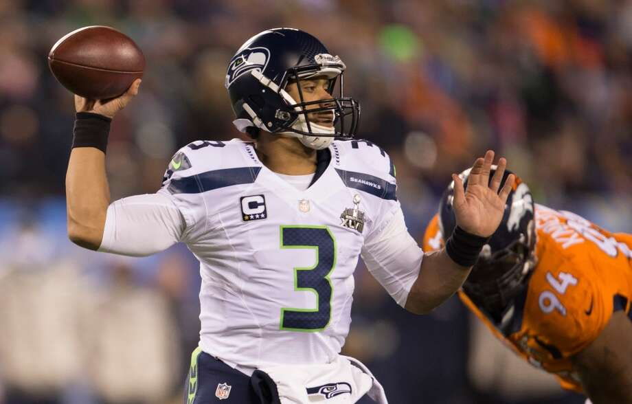 Seattle's Russell Wilson throw as pass during the third quarter at Super Bowl XLVIII Sunday, Feb. 2, 2014, at MetLife Stadium in New Jersey. (Jordan Stead, seattlepi.com) Photo: JORDAN STEAD, SEATTLEPI.COM